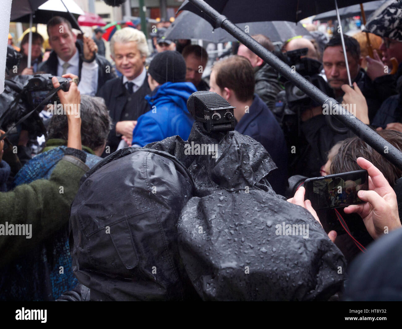 Dutch populist party PVV political leader Geert Wilders in Breda, surrounded by news reporters and bodyguards. - Stock Image