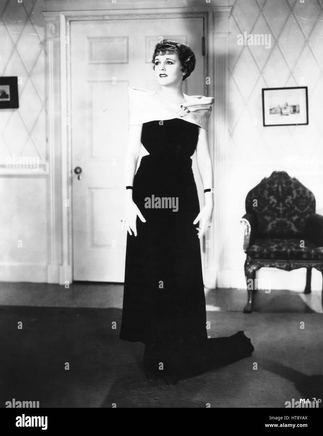 A new fall evening gown: Mary Astor features this new gown of black ...