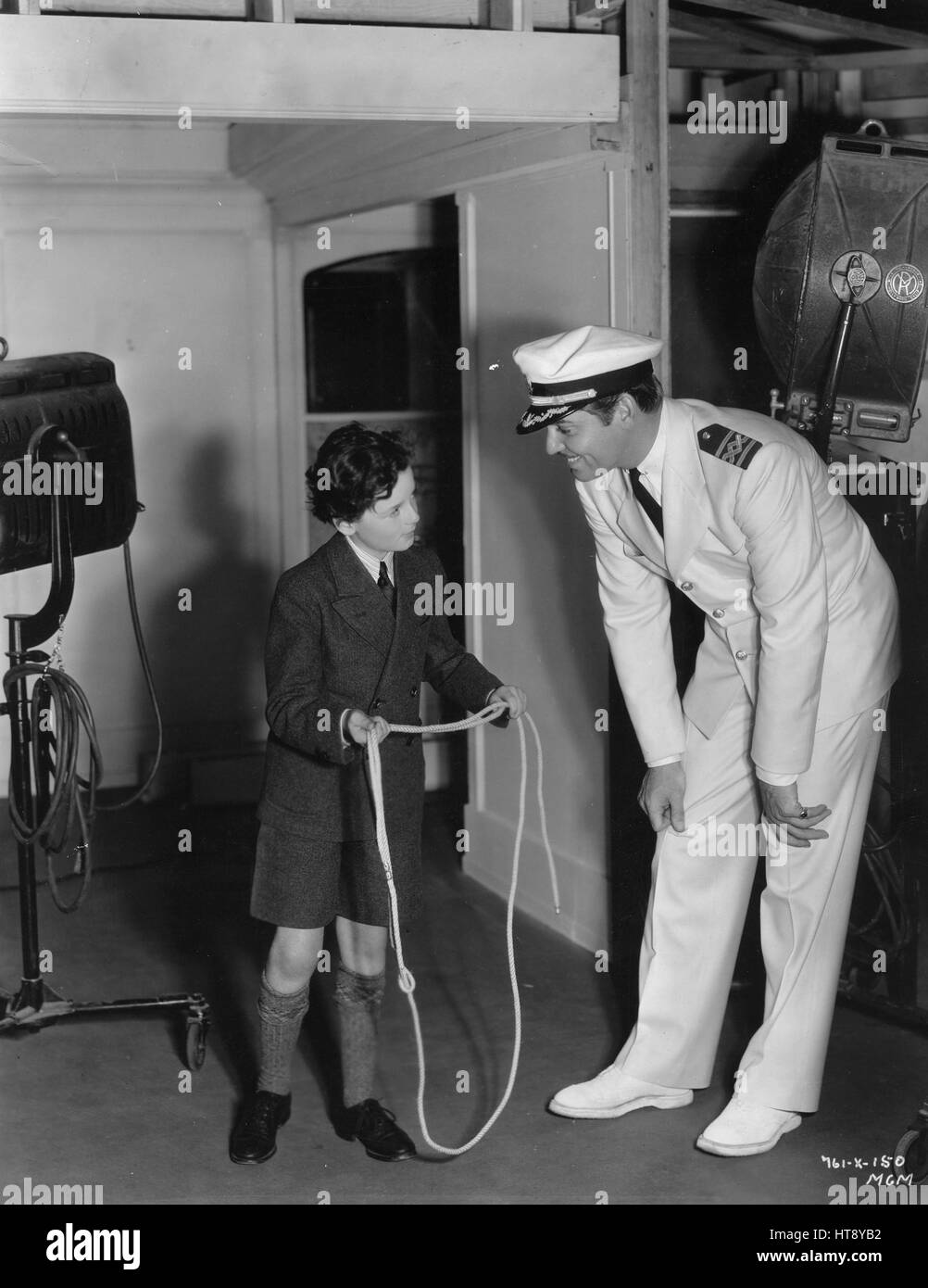 'Rope throwers...Clark Gable and Freddie Bartholomew while away their spare time on the 'China Seas' - Stock Image
