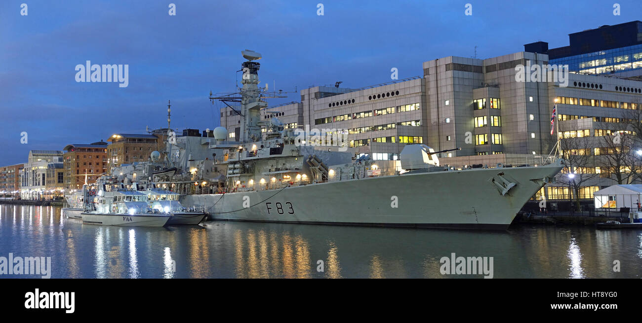 View of the Type 23 frigate HMS St Albans of the UK Royal Navy moored alongside at West India docks at dusk during - Stock Image
