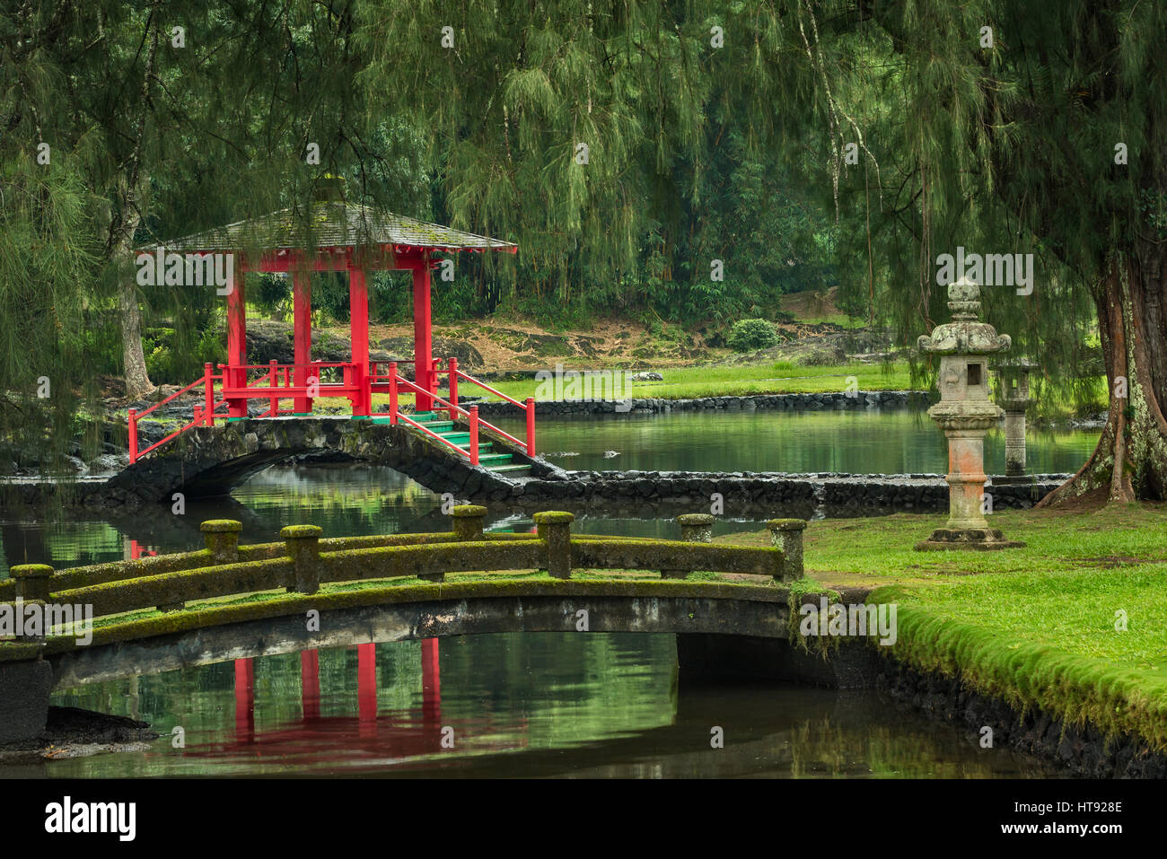 Fishpond, pagoda and bridges in the Japanese Garden of Liliuokalani Gardens in Hilo on the Big Island of Hawaii. - Stock Image