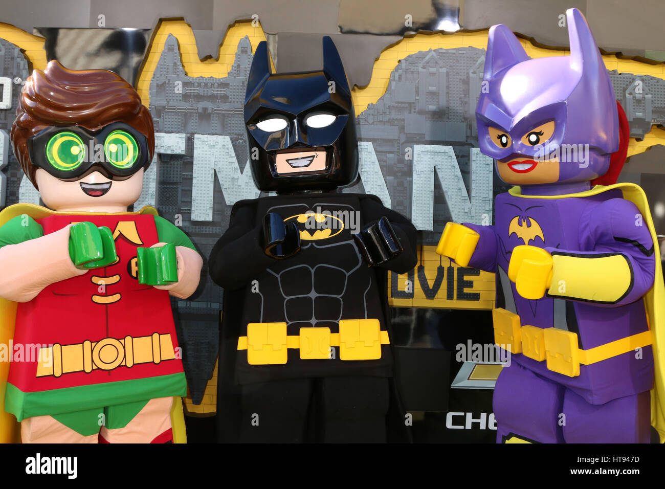 Lego Robin Batman And Batgirl Attending The Premiere Of