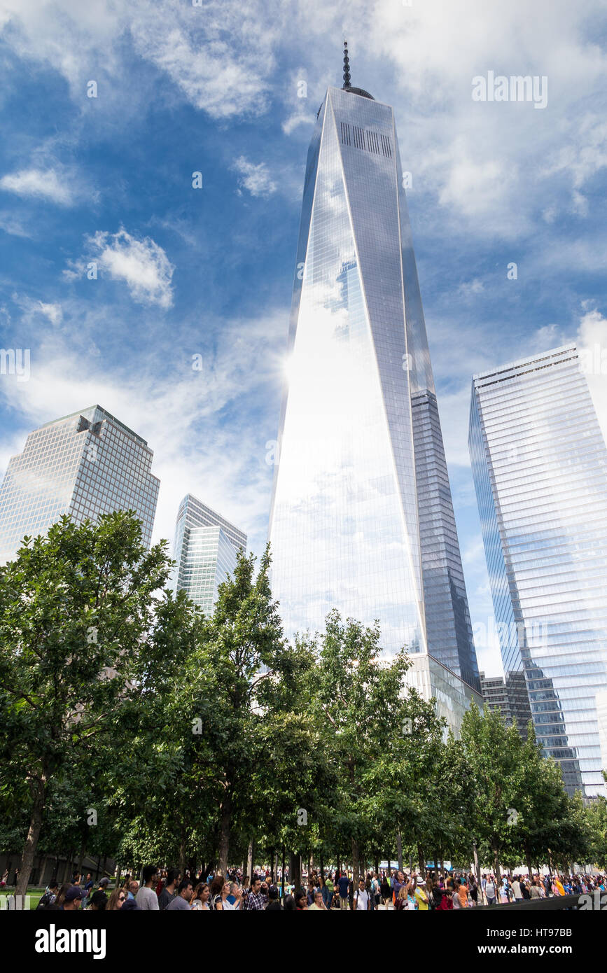 looking up on a standing at a symbolic 1,776 feet tall, 104-story building of One World Trade Center on a partly - Stock Image