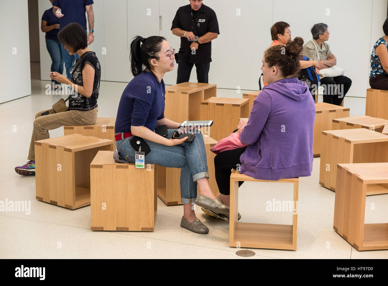 Apple Store Employee During Her One On One Help Session With A Customer  Inside