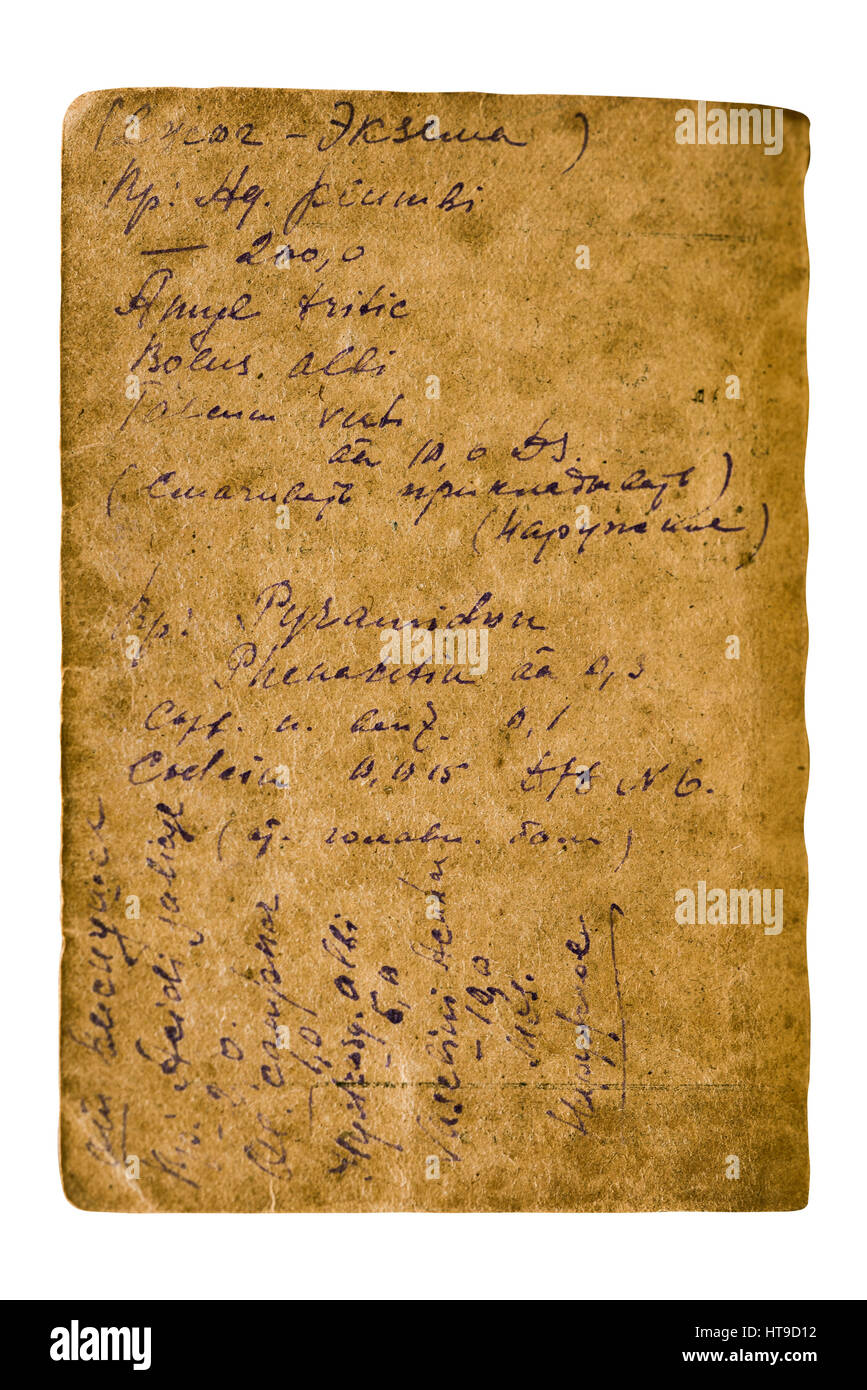 Old sheet of paper with a written ink recipe on a white background - Stock Image