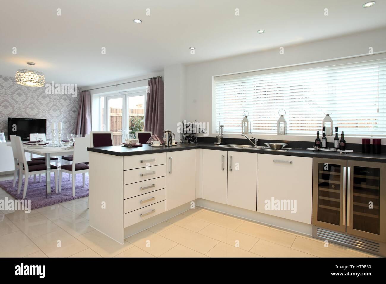 Home Interior Modern Kitchen Diner New Build Home Kitchen In White Stock Photo Alamy