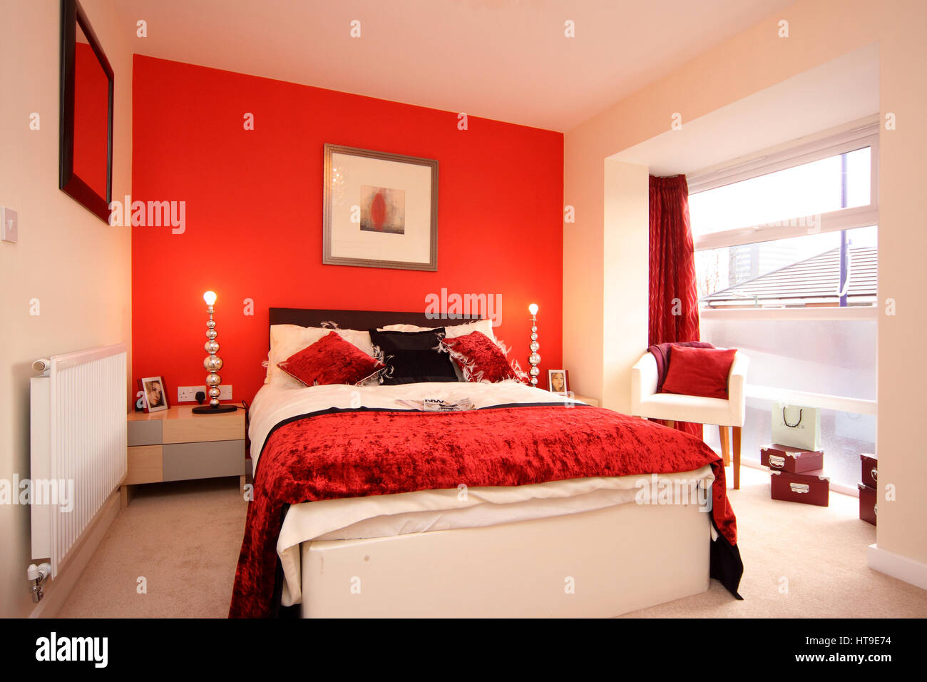 Home interior. bedroom in bright red, feature wall, bed ...