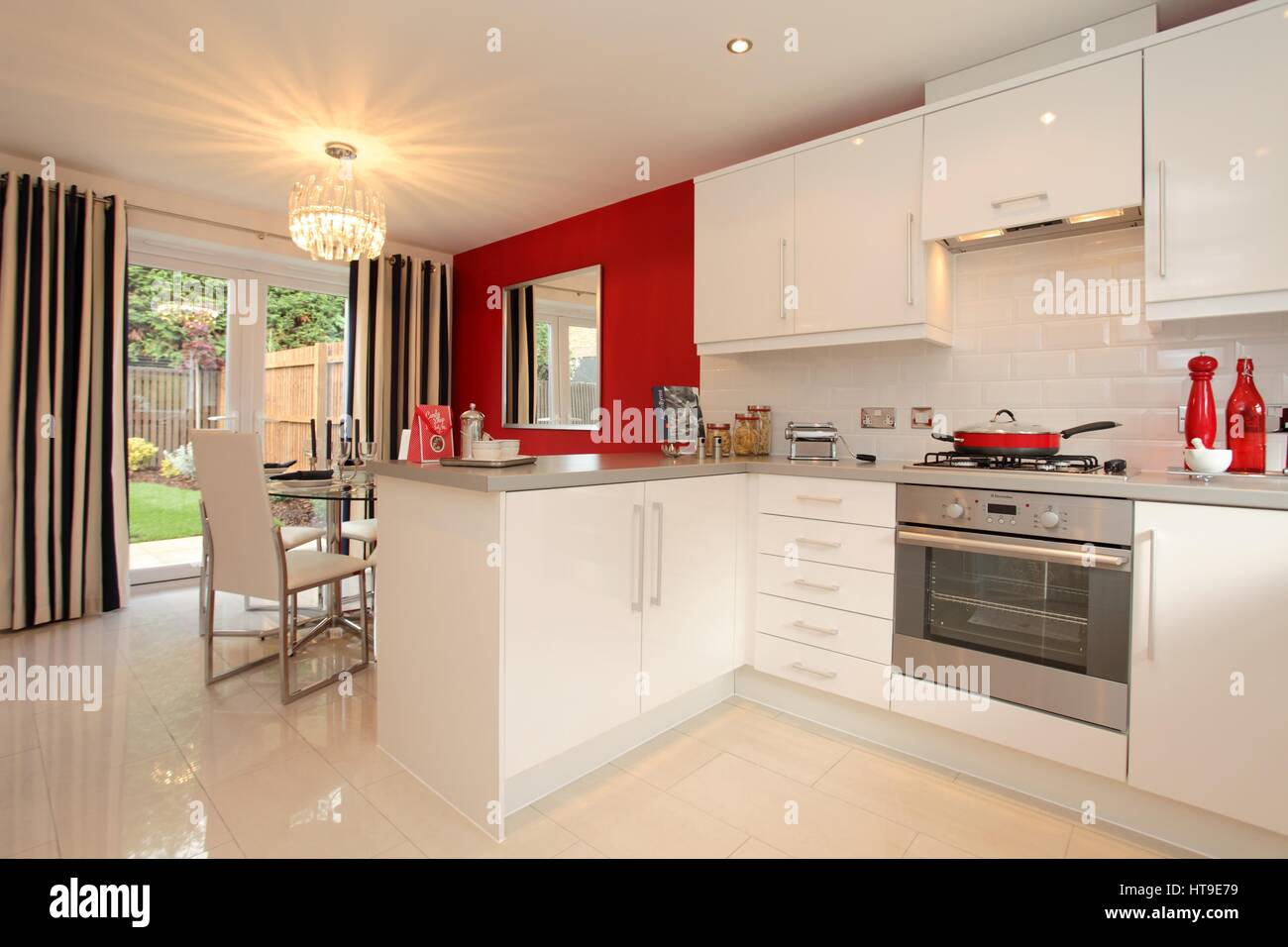 Home interior kitchen modern home new build kitchen diner dining areawhite units red feature wall