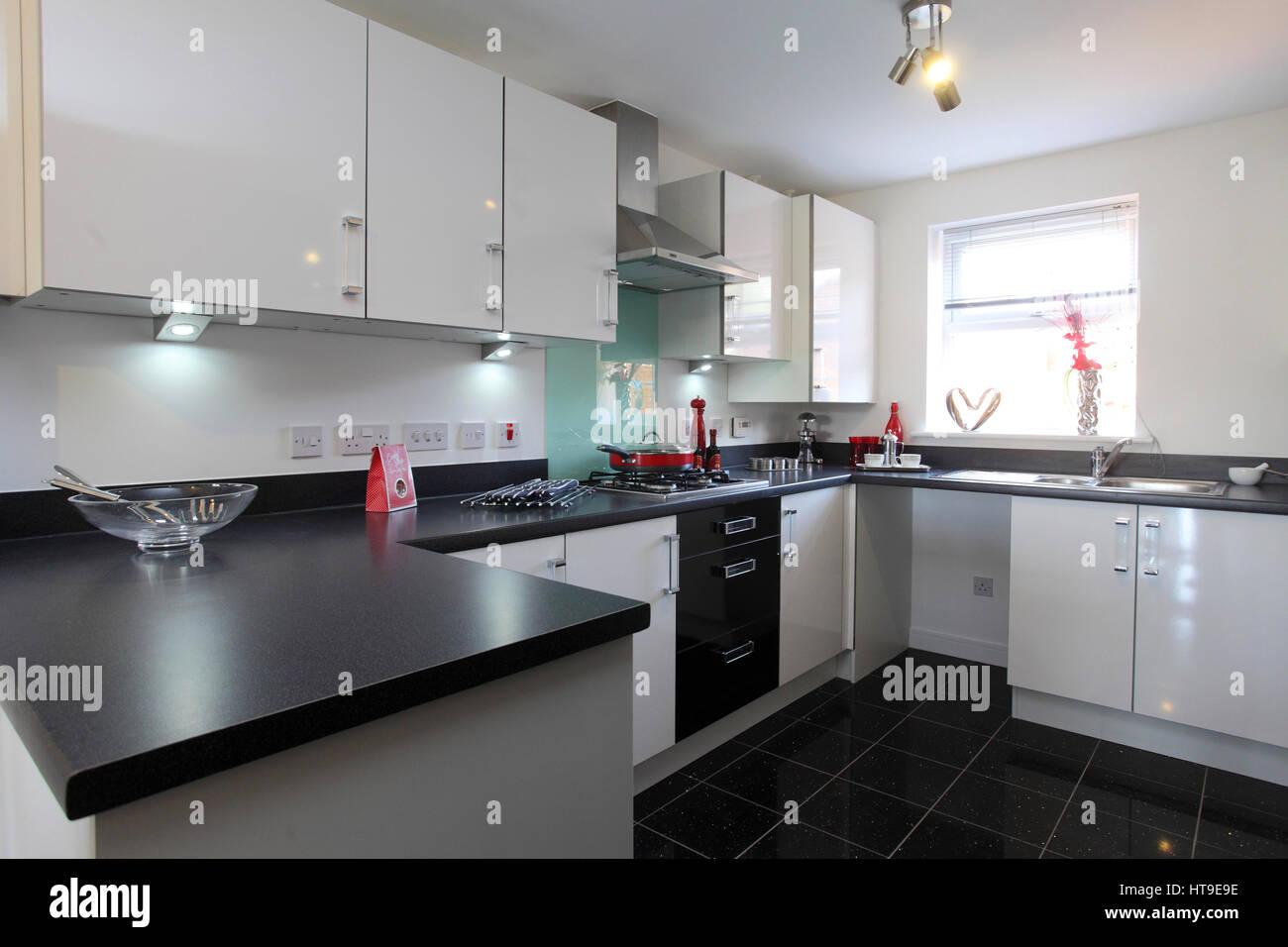 Home interior, modern kitchen, black white units, hob, oven, - Stock Image