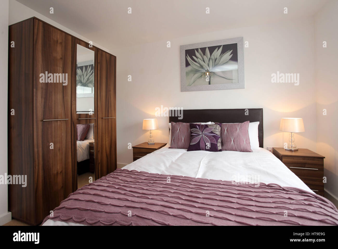 Home interior, bedroom, pink white colours, pink throw, bedspread, modern, new build, - Stock Image