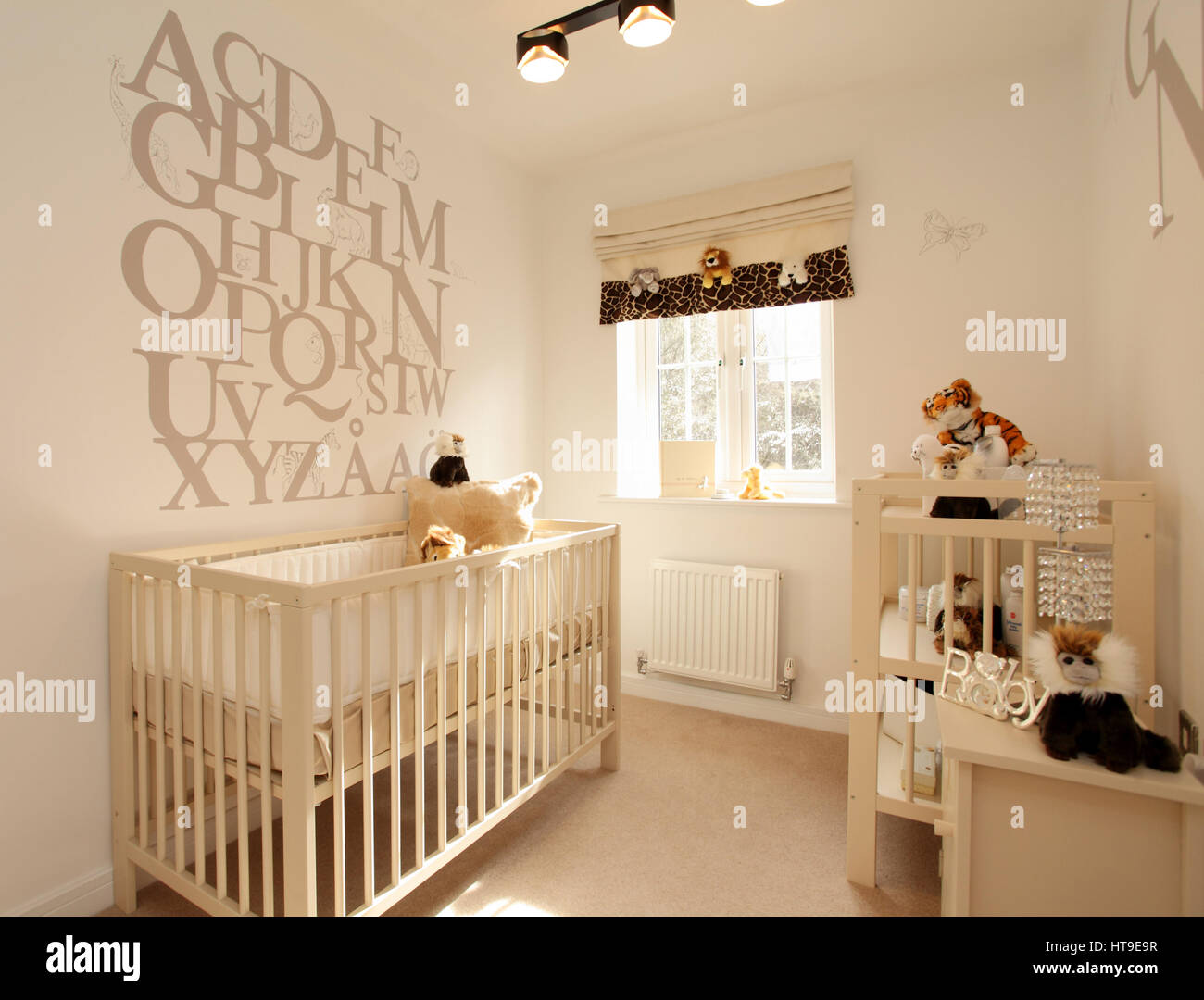 Home interior, childs nursery, decor, alphabet feature wall, cot, soft toys, baby, - Stock Image