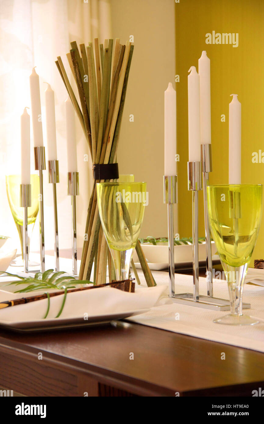 Home interior, green amber, wine glasses, dining table, candles, table laid, dinner, lunch, - Stock Image