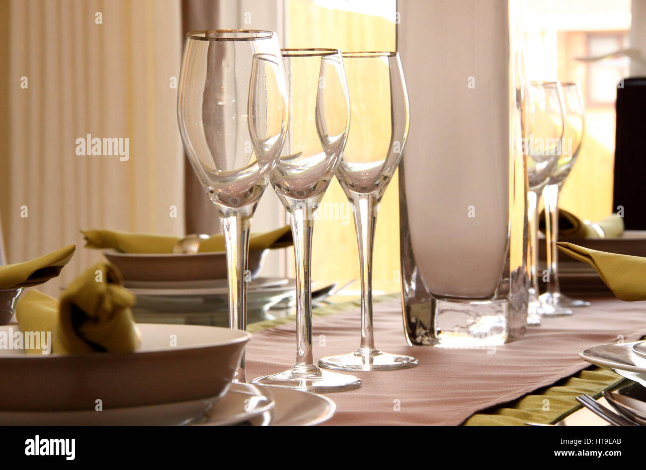 Home interior, dining table, wine glasses, cutlery, eating in, table laid, guests, welcome, friends, lunch, dinner, - Stock Image