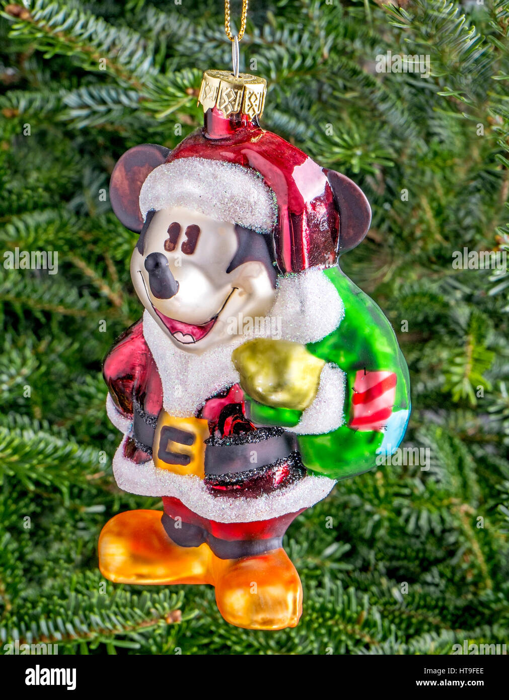 christmas bauble hanging from a tree in the shape of mickey mouse stock image