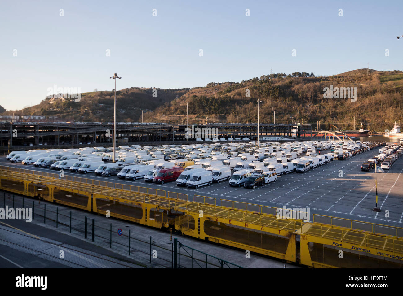New vans waiting to be shipped at Pasajes seaport (Basque country, Spain) 2017. - Stock Image