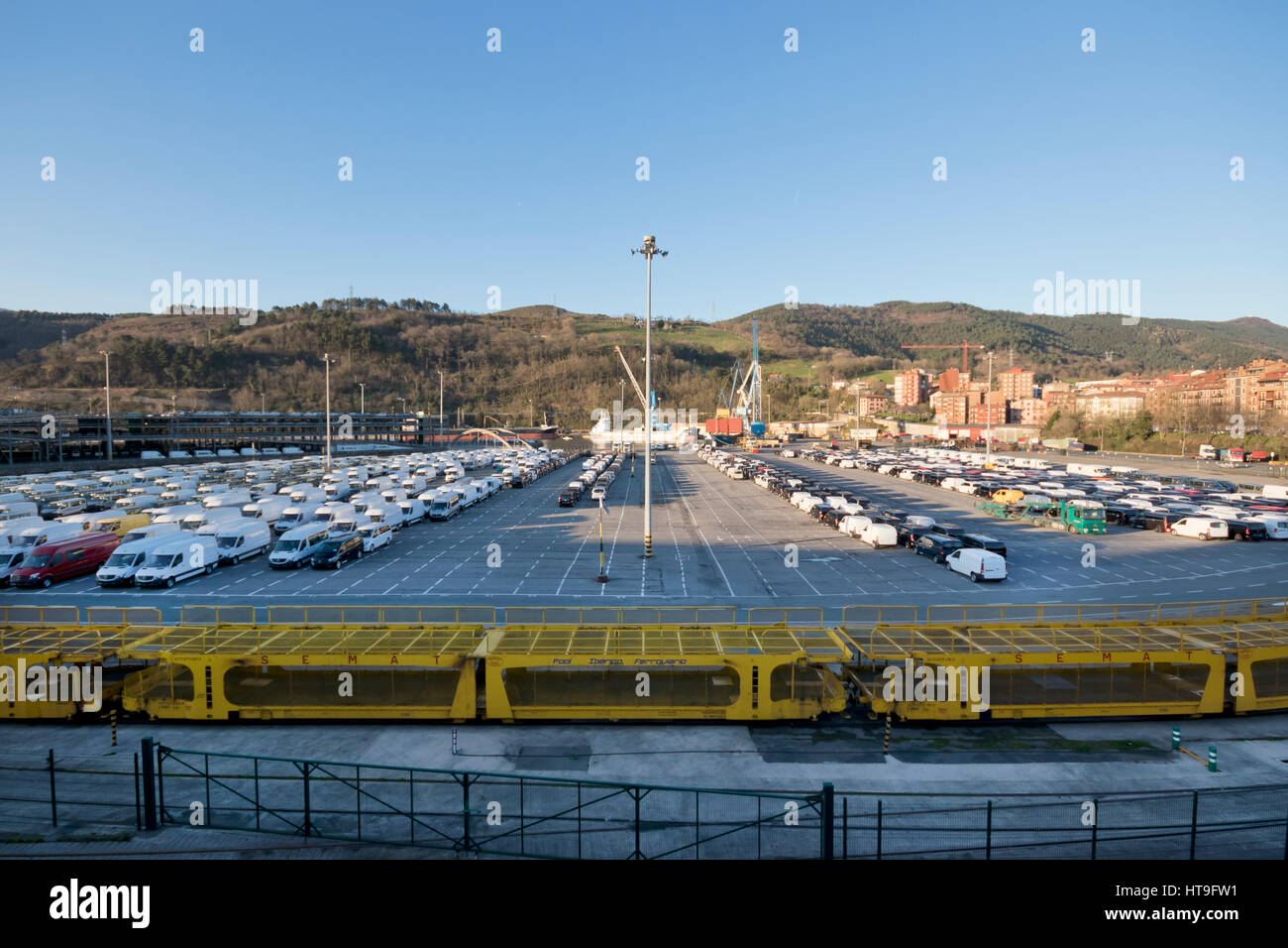 Wide angle view of new vehicles waiting at Pasajes seaport (Basque country, Spain) 2017. - Stock Image