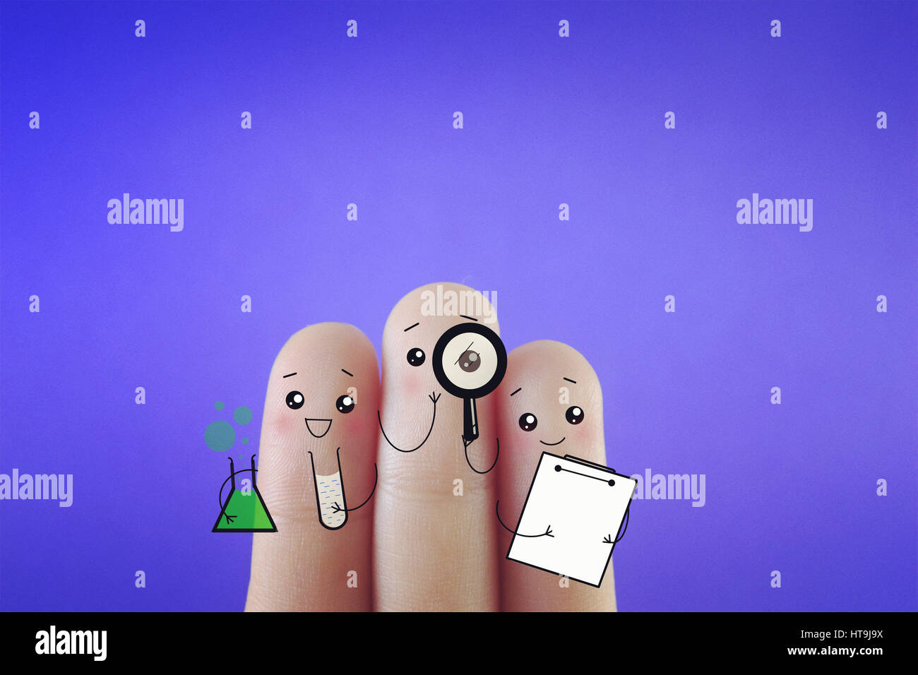 Three fingers decorated as three happy friends doing research. Suitable to be used for anything about science and - Stock Image