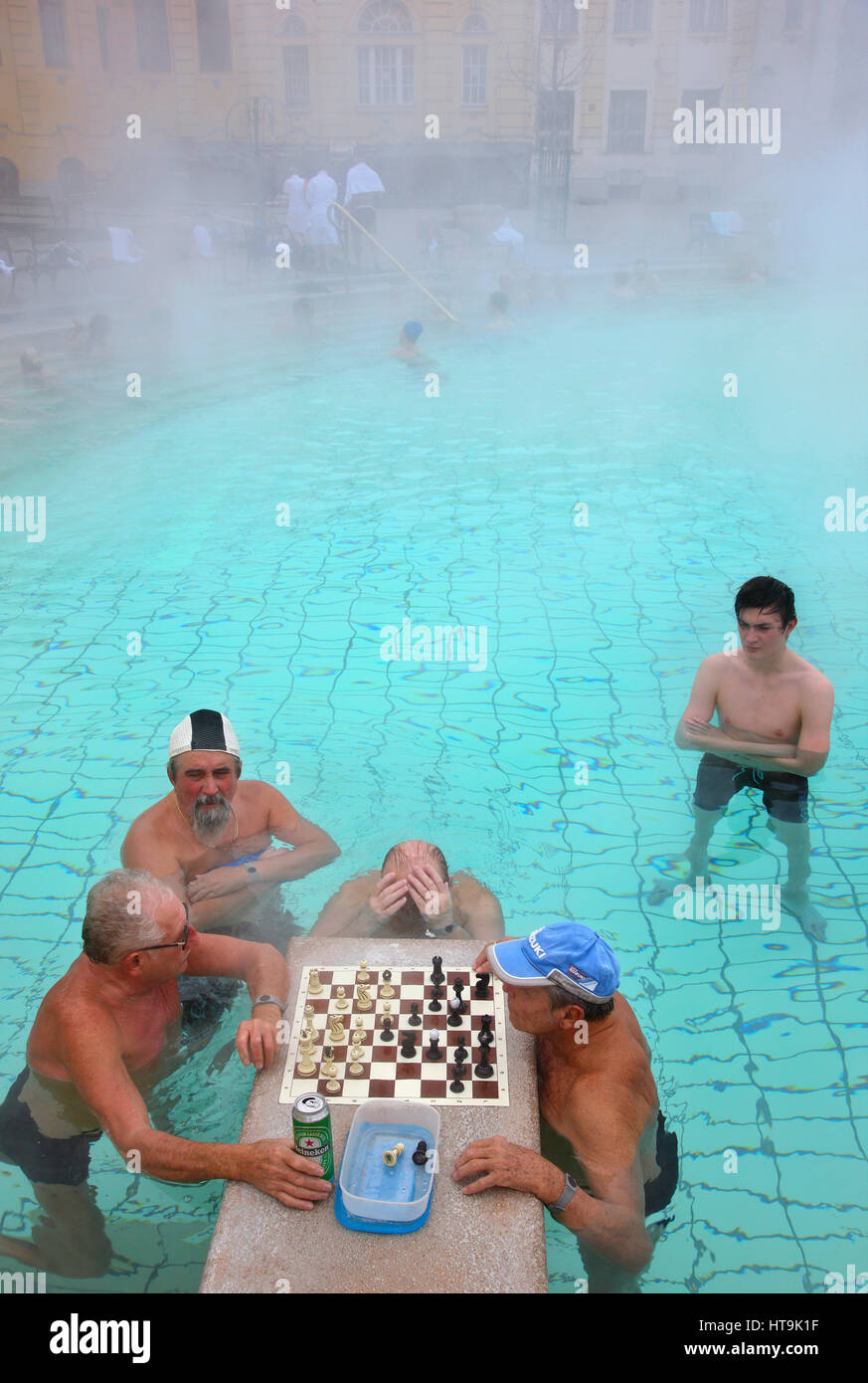 People playng chess at the The Széchenyi Medicinal Bath in City Park (Varosliget) Budapest, Hungary. It is - Stock Image