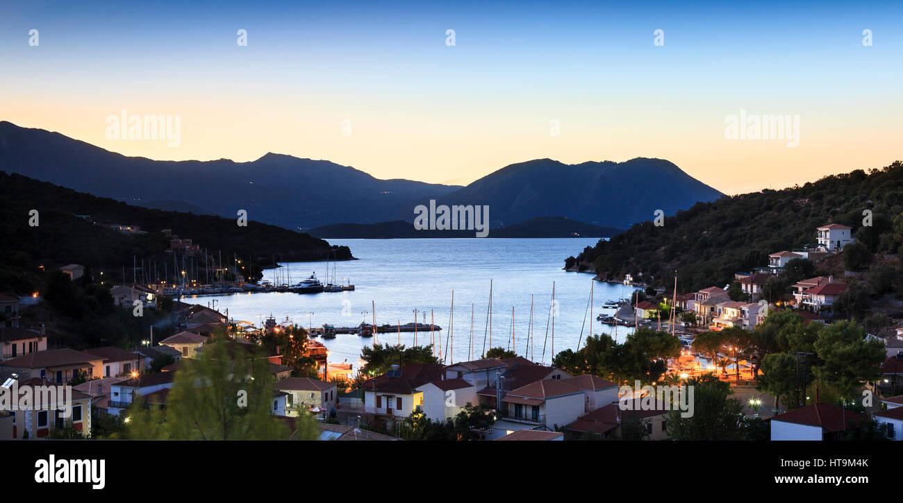 Sunset over Valhi harbour, Meganissi, Greece - Stock Image