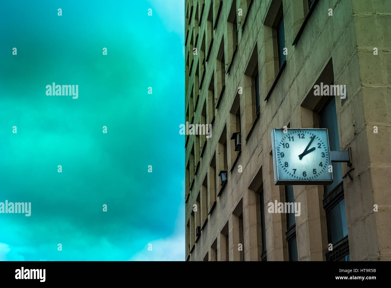 Mysterious russian building (public property) with an old clock - Stock Image