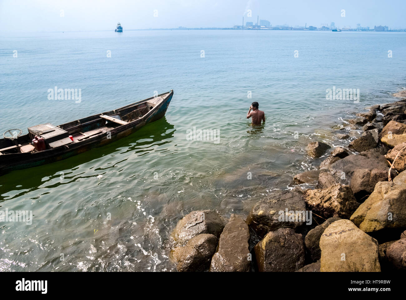 A man dives to collect abandoned and unused goods at the bottom of coastal water in Jakarta, Indonesia. © Reynold - Stock Image
