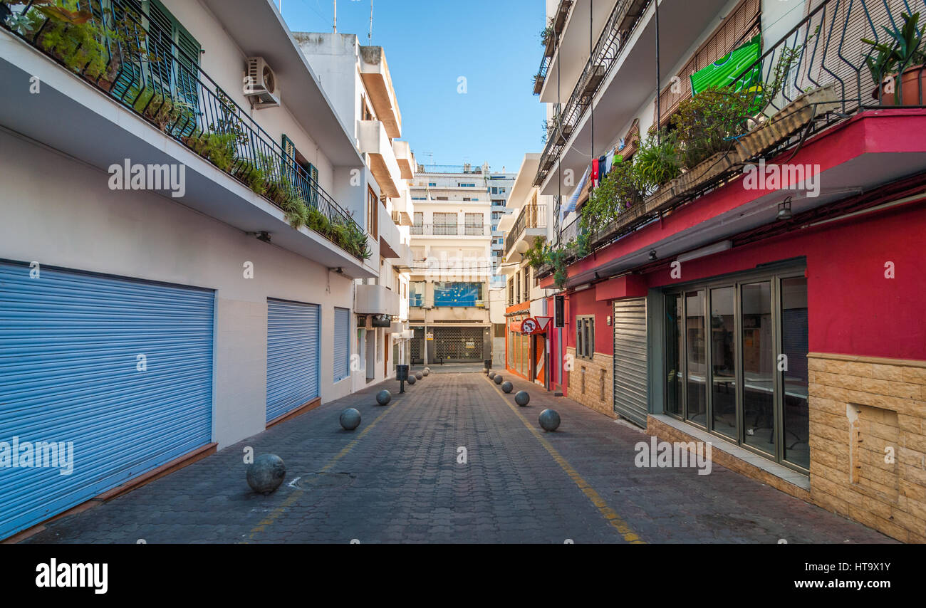 Vacant & shaded, empty alleyway on otherwise bright sunlit day in Sant Antoni De Portmany.  Ibiza in quiet off-season in the afternoon. Stock Photo