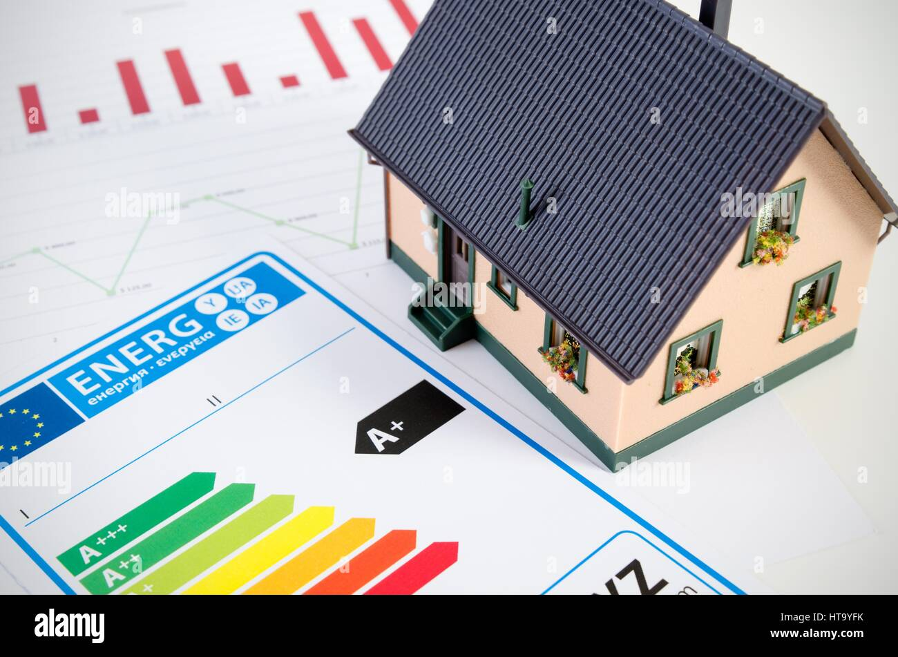 Energy efficiency concept with house model and documents on desk - Stock Image