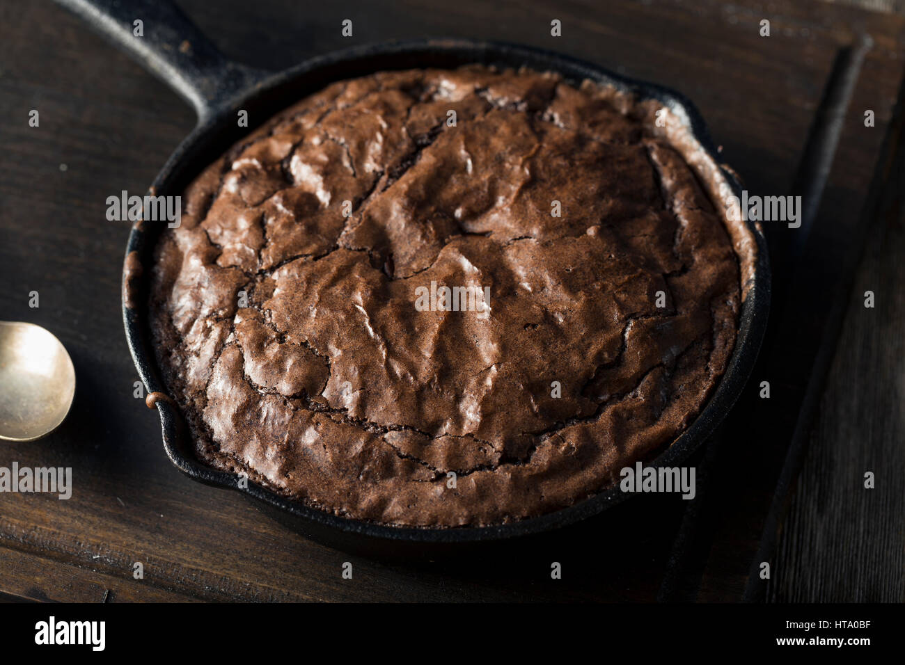 Homemade Sweet Dark Chocolate Brownie in a Skillet Ready to Eat - Stock Image