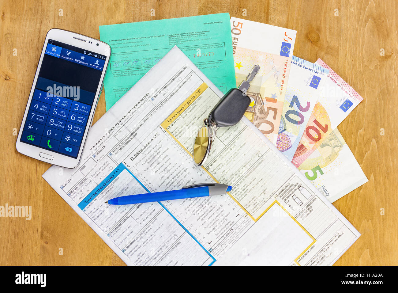 International automobile insurance documents with car keys, euro cash and smartphone - Stock Image