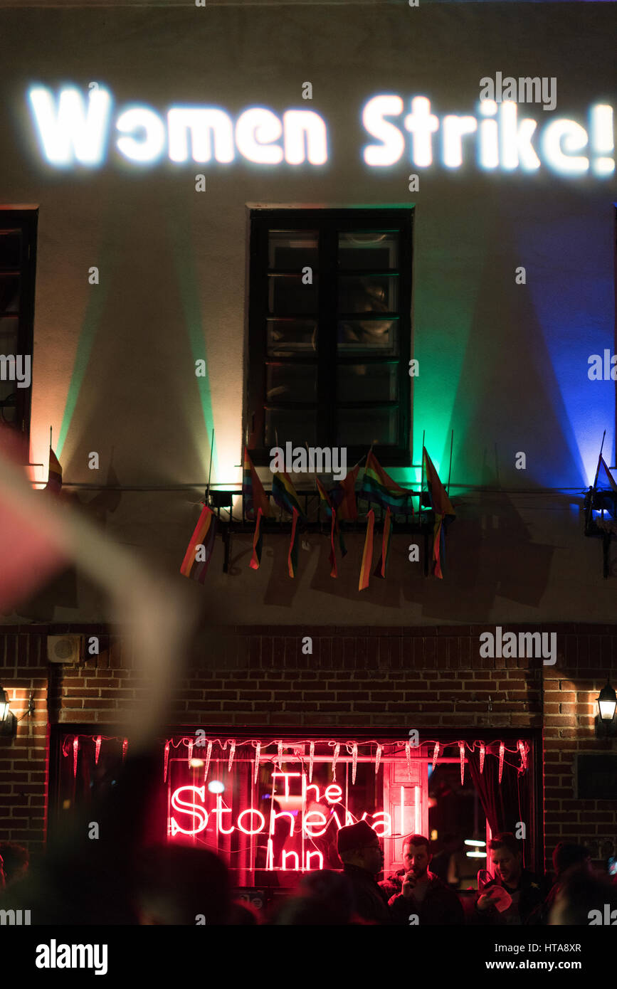 "New York City, USA. 8th March 2017.  ""Women Strike!"" being projected onto The Stonewall Inn during the International - Stock Image"