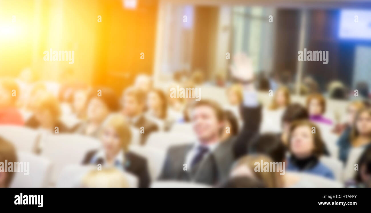 People sitting in conference room - Stock Image