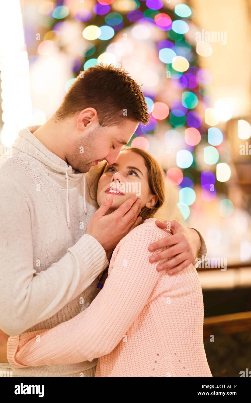 Photo of happy hugging couple - Stock Image