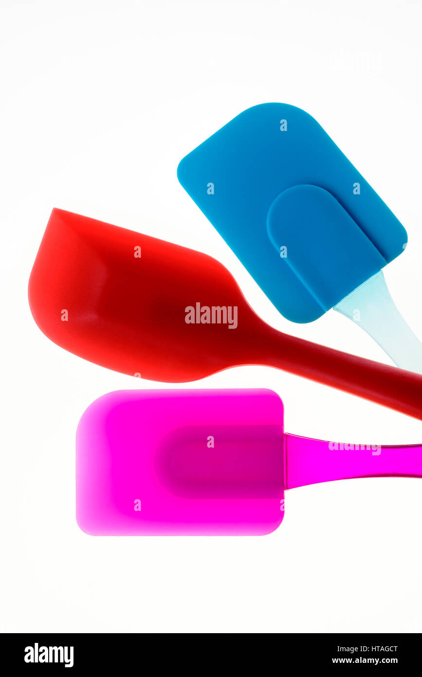 Colourful spatulas baking accessories equipment, broad blade flexible spatula. - Stock Image