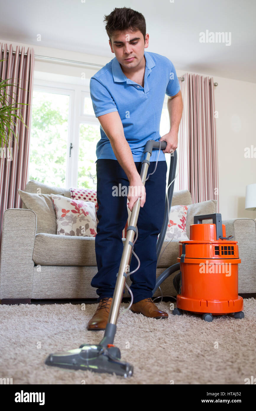 Young Man Professionally Cleaning Carpets - Stock Image