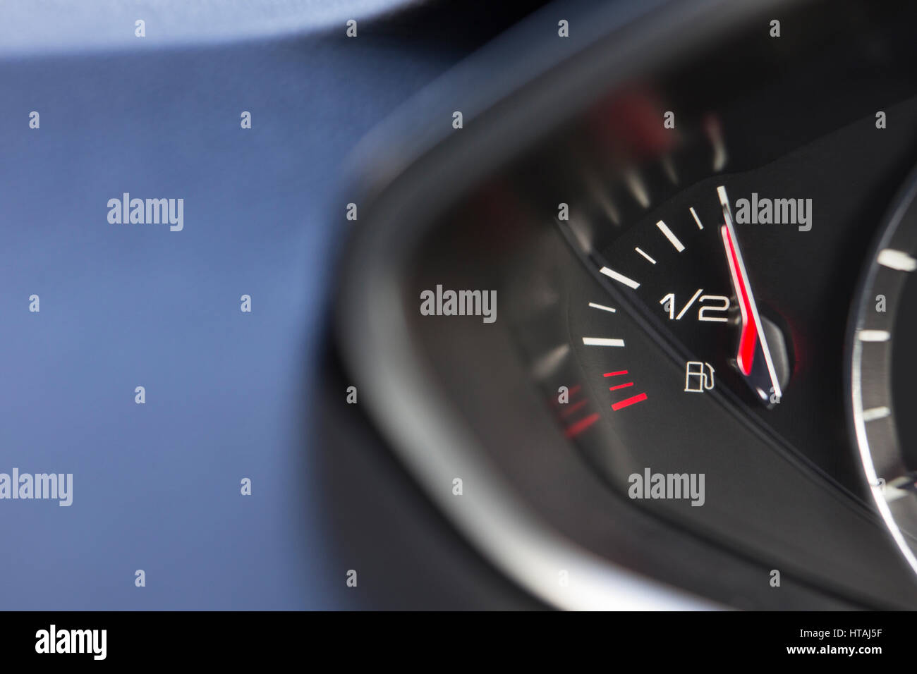 Close Up Of Fuel Gauge In Car Registering Full - Stock Image