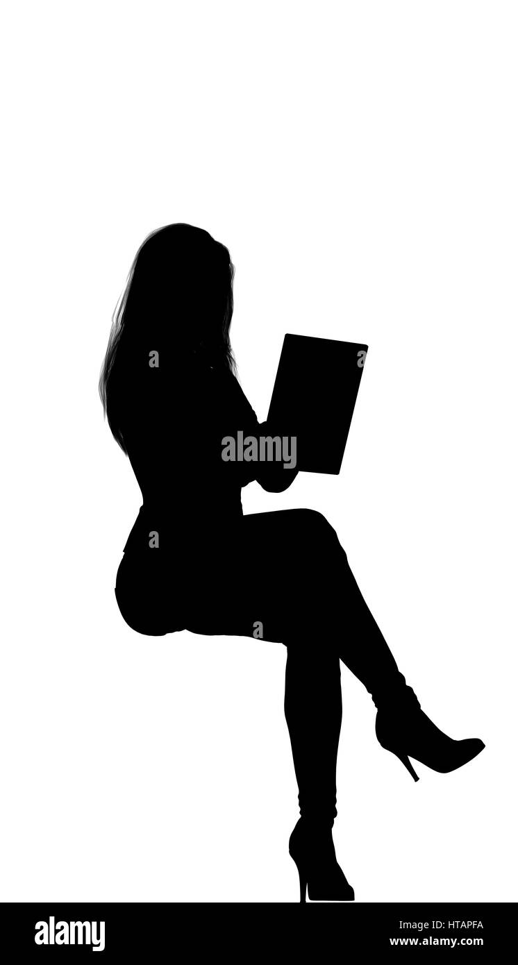 Women siting on the rear front looking her tablet. Long hair, fit, high heel. Stephanie. Front side view - Stock Image