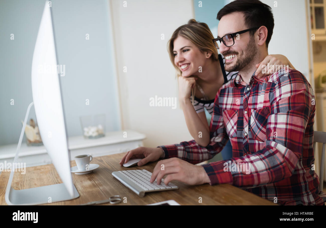 Couple working on startup project together from home - Stock Image