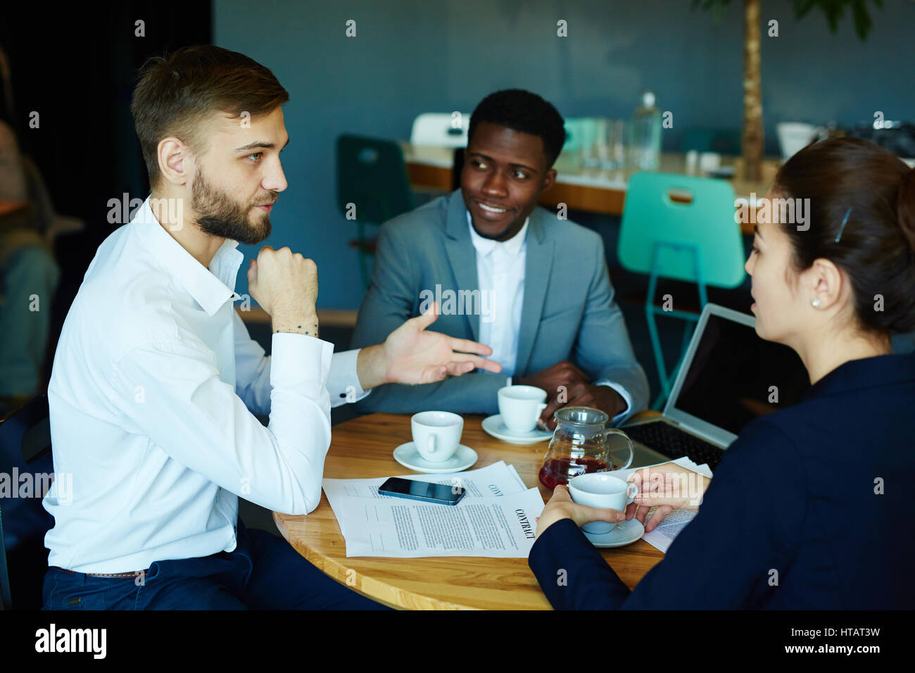 Businessman talking to one of candidates for new vacancy - Stock Image