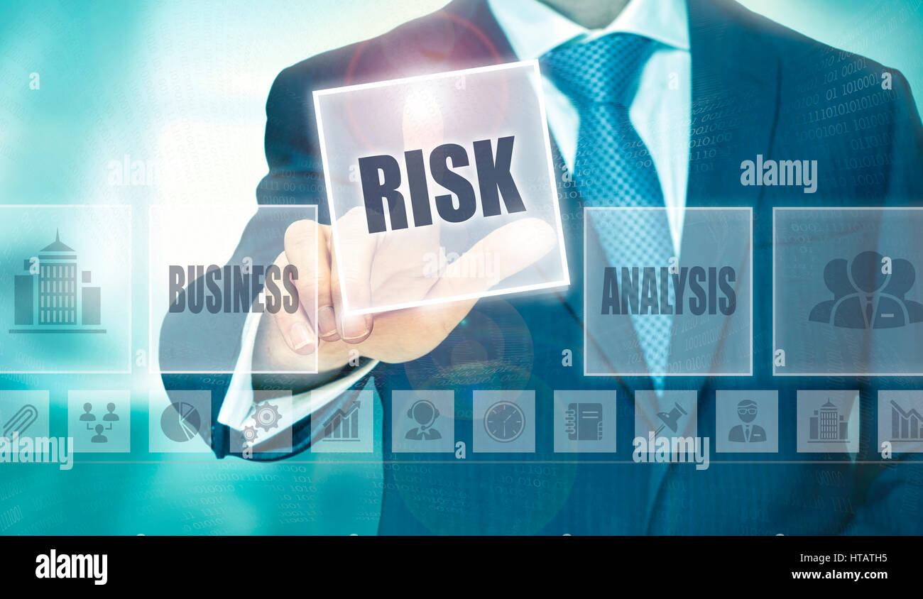 Businessman pressing an Risk concept button. Stock Photo