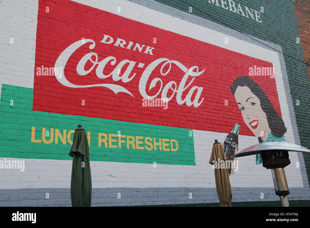 Coca cola sign painted on brick wall - Stock Image