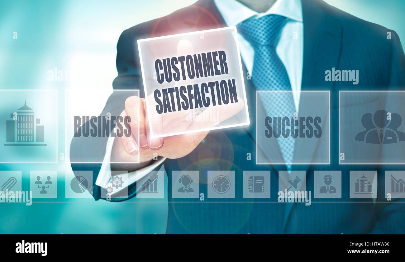 A businessman pressing a Customer Satisfaction button on a transparent screen. - Stock Image