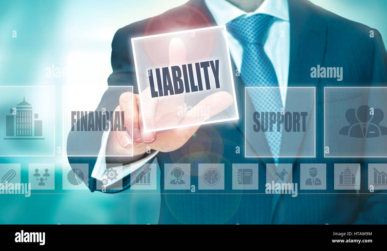 A businessman pressing a Liability button on a transparent screen. - Stock Image