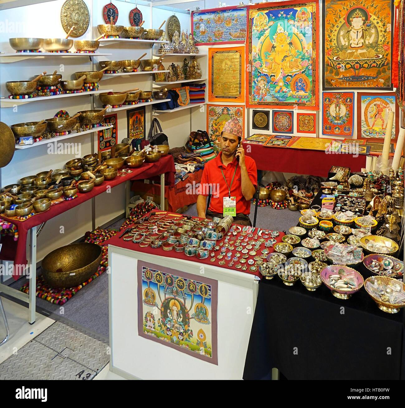 KAOHSIUNG, TAIWAN -- OCTOBER 8, 2015: A stall sells Tibetan religious artifacts at a local trade fair. - Stock Image