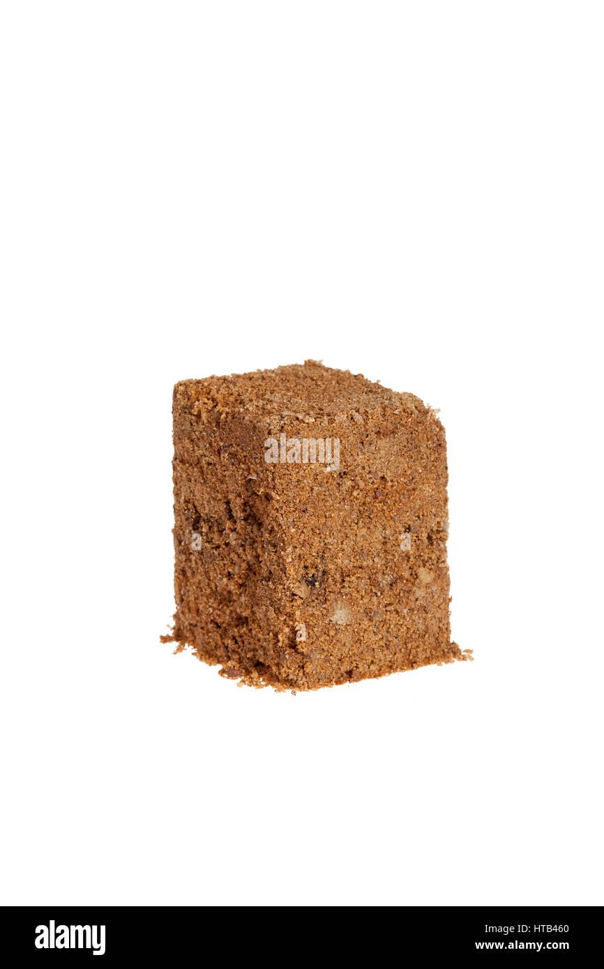 Cube of sand isolated on white background. - Stock Image
