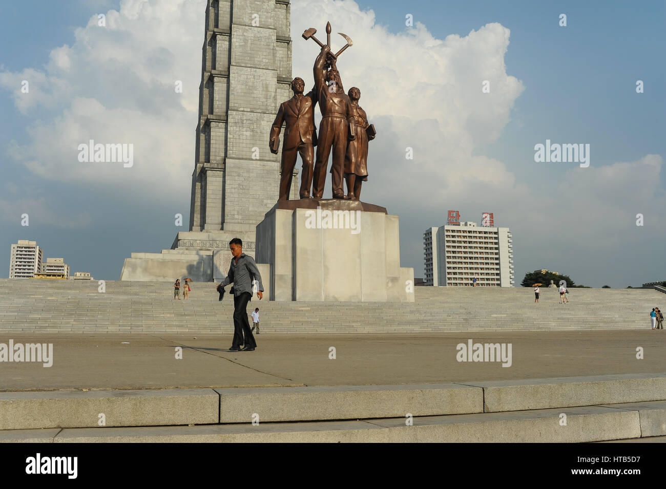 08.08.2012, Pyongyang, North Korea - A man walks by the tower of Juche Idea memorial near the shores of the Taedong - Stock Image