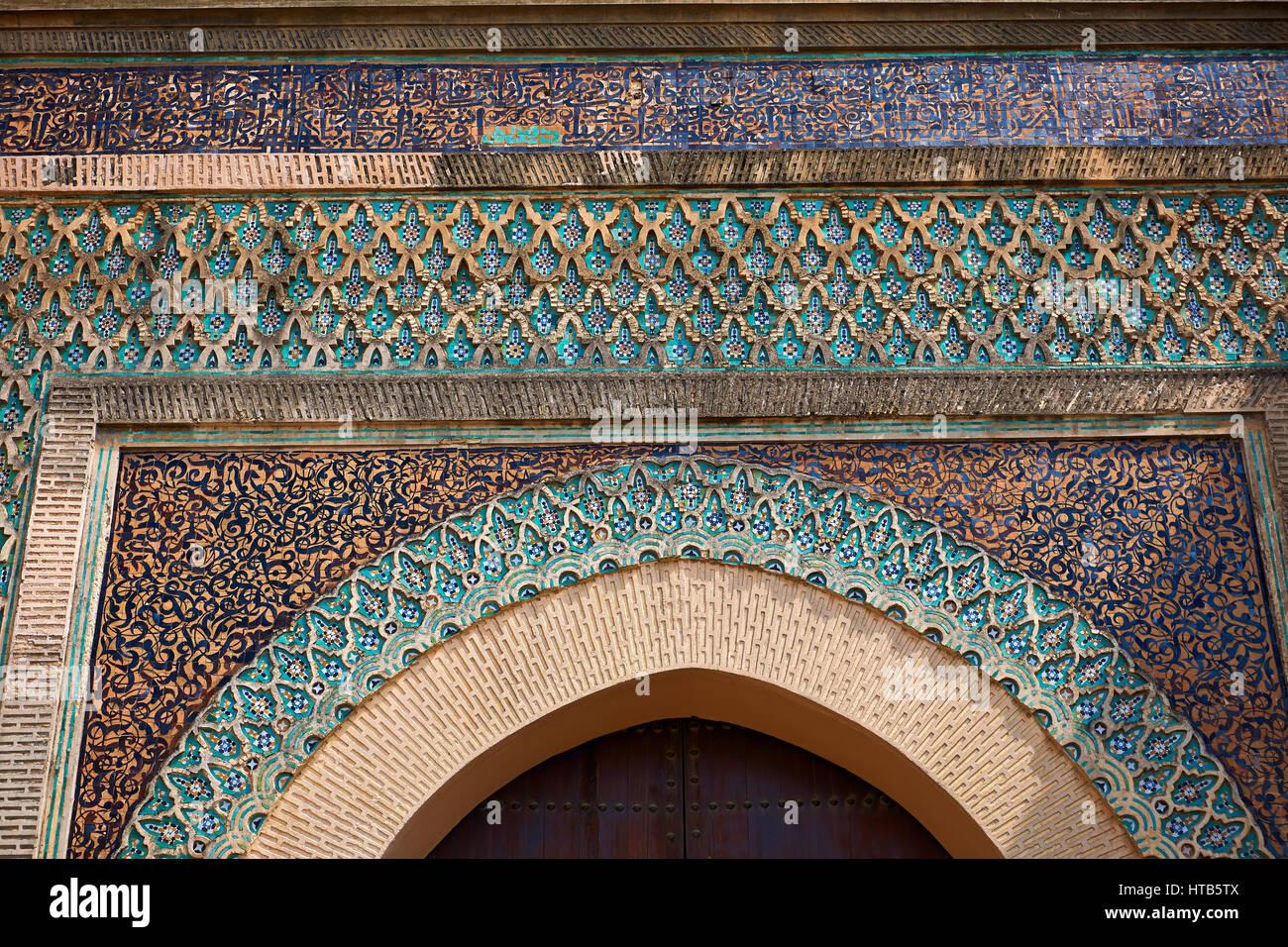 Zellij mosaics and arabesque Moorish plasterwork of the Bab Mansour gate. Named after the architect, El-Mansour, Stock Photo