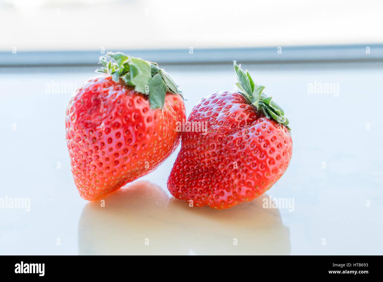 Close up of fresh strawberries on white background - Stock Photo