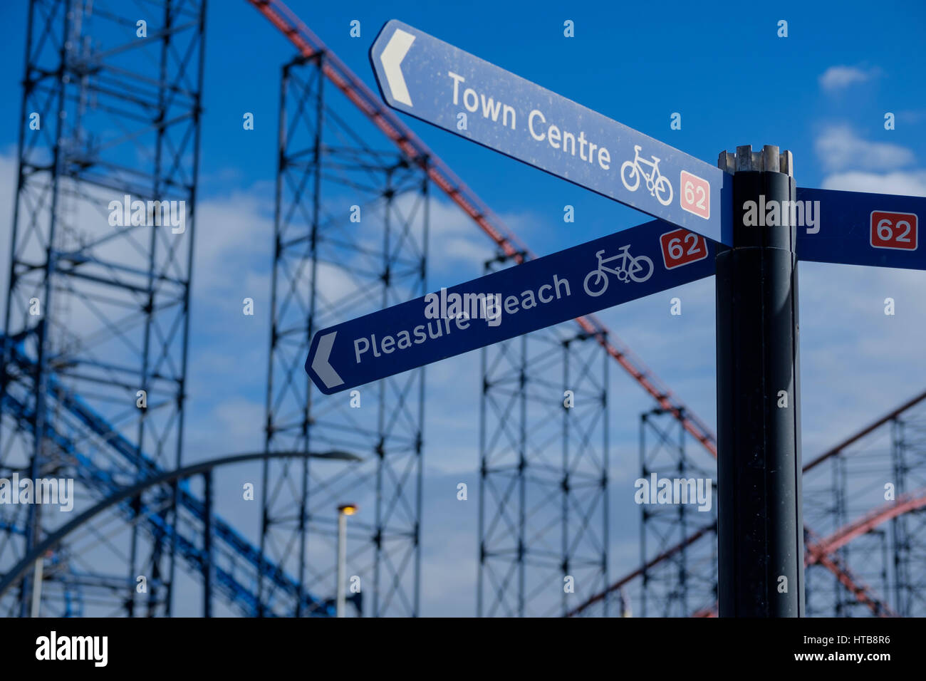 Blackpool Pleasure Beach signpost on the promenade - Stock Image