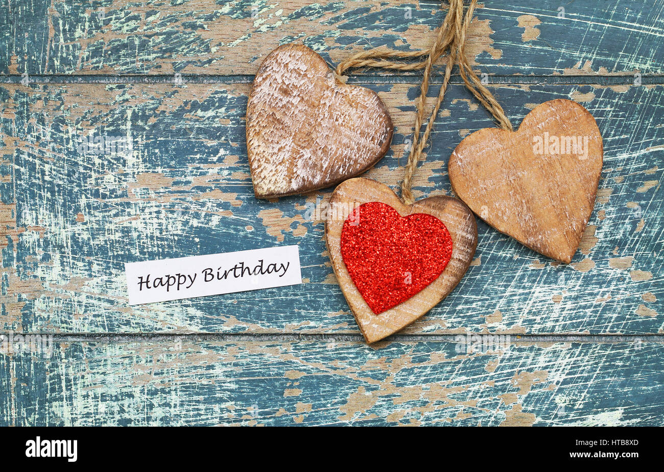 Happy Birthday Card With Wooden Hearts On Rustic Surface