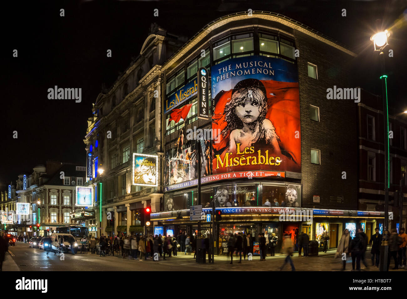 London's West End at night with Les Miserables at Queens Theatre in Shaftesbury Avenue. Stock Photo